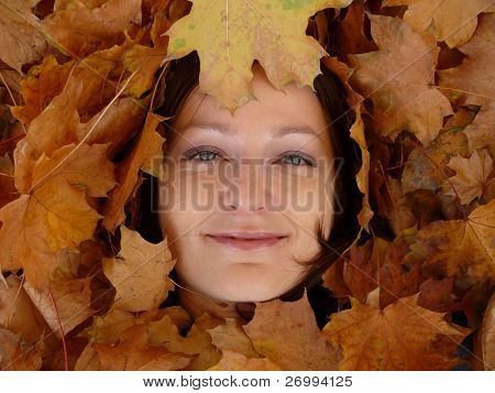 Woman face in leaves
