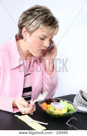 Attractive Woman Eating Fresh Fruit
