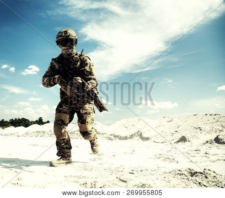 Airsoft game player running with weapon replica poster