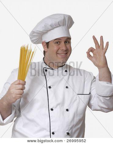 Cook holding crude pasta.
