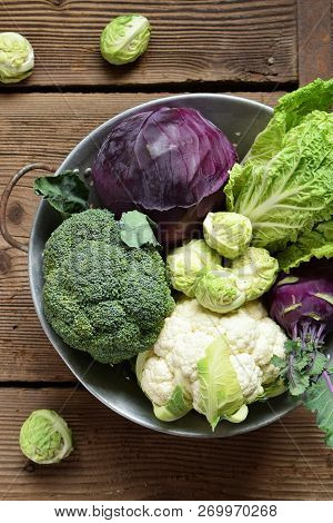 Different Varieties Of Cabbages On Wooden Background. Organic Fresh Vegetables - Cauliflower, Kohlra