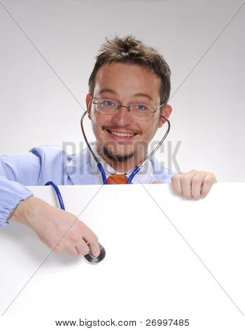 A doctor usin a Stethoscope over a white card.