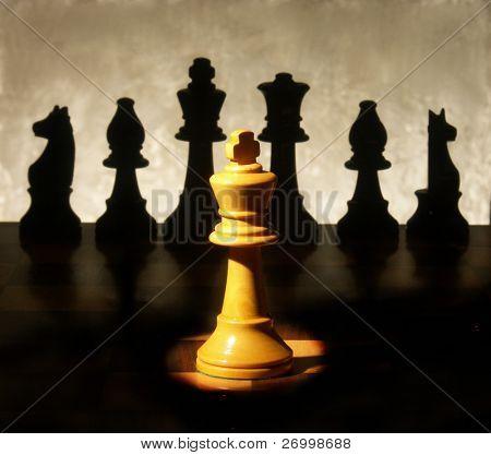 chess man over business chart admonish to strategic behavior