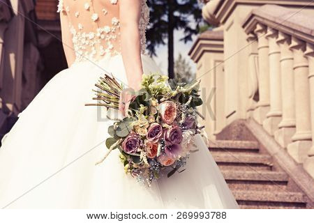 Young Bride In A White Dress With A Beautiful Wedding Bouquet On A Marble Staircase In An Old Castle