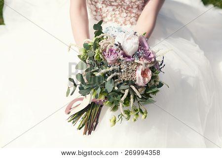 Bride Holds A Wedding Bouquet, Wedding Dress , Wedding Details. Wedding Ceremony Concept.