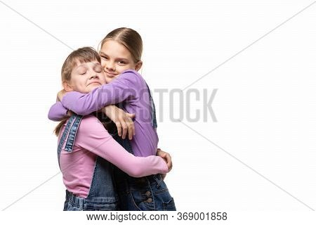 Two Girlfriends Happily Hug Each Other, White Background