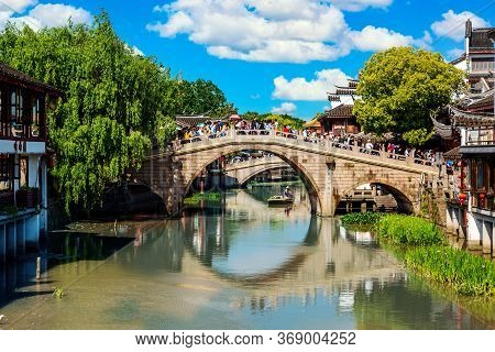 Shanghai, China - May, 2019: Landscape Of Qibao Old Town In Shanghai, China. Brick Bridge Over The R