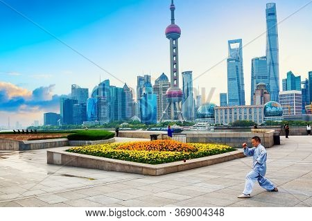 Shanghai, China - May, 2019: Man Making Exercise Training Against Shanghai Pudong Skyline Business D