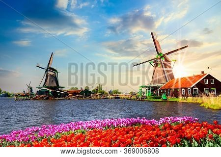 Typical Iconic Landscape With Beautiful Sunset In The Netherlands, Europe. Traditional Old Dutch Win