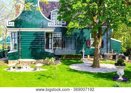 Traditional Green Dutch House In The Zaanse Schans Village With Green Meadow. Typical Netherlands Im