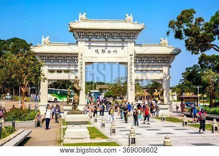 Hong Kong, Sar China - May, 2019: Po Lin Monastery Entrance With People Near The Big Tian Tan Buddha
