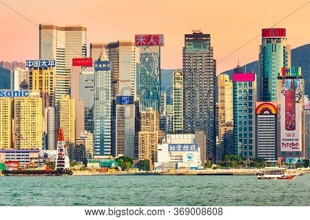Hong Kong, China - May, 2019: Hong Kong Skyscrapers In The Evening Over Victoria Harbour During Twil
