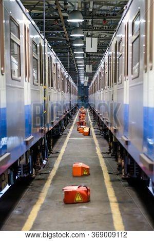 Subway train service at depot perspective