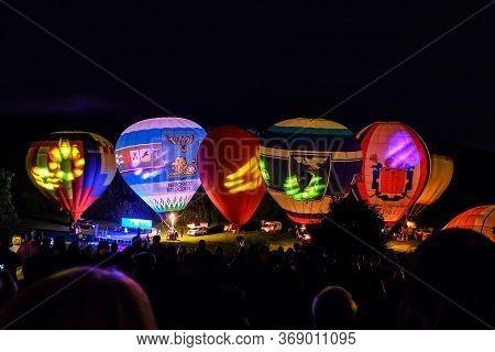 Belgorod, Russia - August 02, 2019: Annual Festive Night Glow Of Balloons Near Oak Forest. Festival