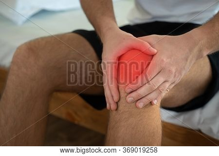 Man Patient Holding Knee In Pain. Man With Knee Pain. Man With Chronic Knee Problems And Pain Man Wi