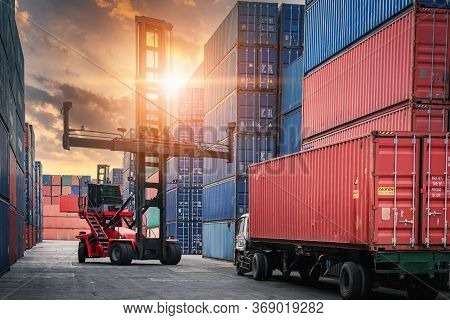 Container Cargo Port Ship Yard Storage Of Logistic Transportation Industry. Forklift Is Stacking Con