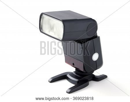 Photo Camera Flash On Stand, Isolated On White Background
