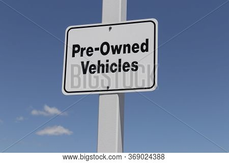 Pre Owned Vehicles Sign At A Used Car Dealership.