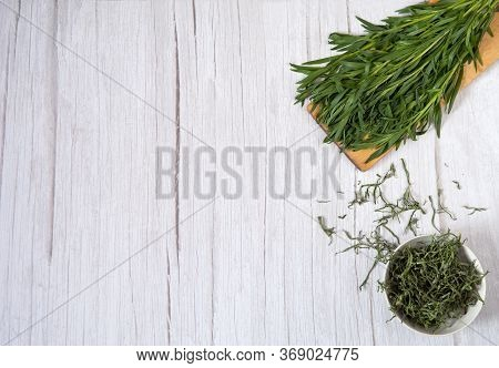 Drying Of Greens With Preservation Of Vitamins. A Bunch Of Fresh Tarragon On A Cutting Board And A C