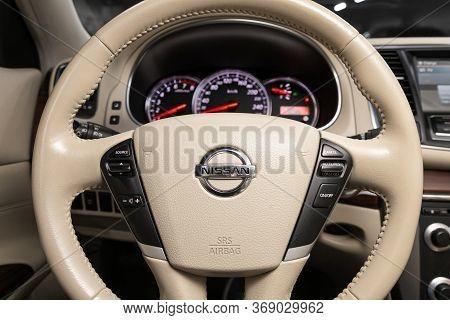Novosibirsk/ Russia - April 11, 2020:  Nissan Teana, Black Luxury Car Interior - Dashboard, Player,
