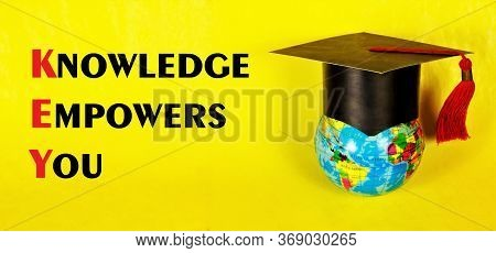 Knowledge Gives You Power - The Inscription Of The Text On The Background Of The Student's Cap And T