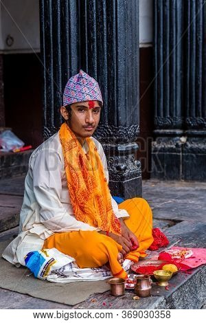 Kathmandu,nepal - August 14,2019: Hindu Priest Waiting People To Tie Sacred Thread During Janai Purn