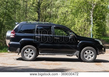 Novosibirsk/ Russia - May 12, 2020, Black  Toyota Land Cruiser,  Side View.  New Expensive Jeep Made