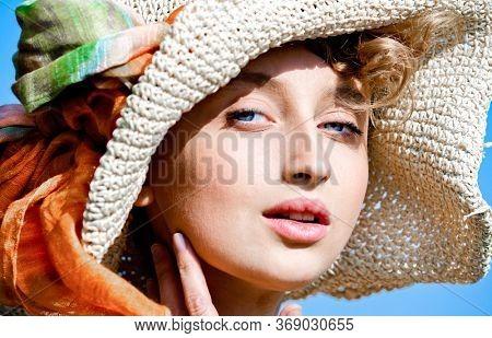 Woman portrait in a straw hat