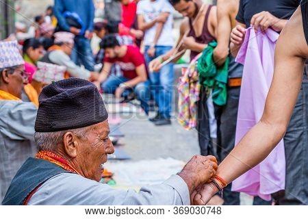 Kathmandu,nepal - August 14,2019: Hindu People Receiving Sacred Thread Rakshya Bandhan From Priest D
