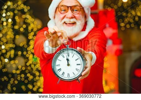 Santa Claus With Real Beard Holding Clock. Santa Claus Is Looking At His Watch. Santa Claus With Ala