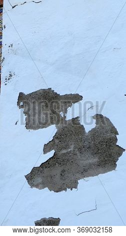 Peeling Paint Exposes Cartoon Character On Village Wall