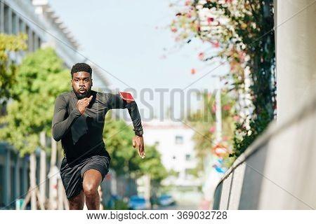 Determined Young Black Sportsman Running Sprint Triathlon