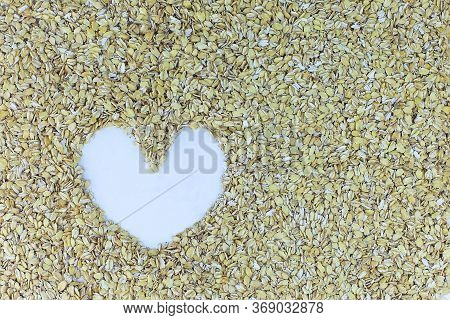 Organic Raw Rolled Oats In Heart Shape. Texture