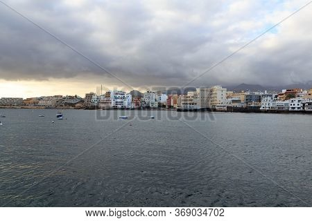 El Medano Panorama With Hotels, Atlantic Ocean And Dark Clouds On Canary Island Tenerife, Spain