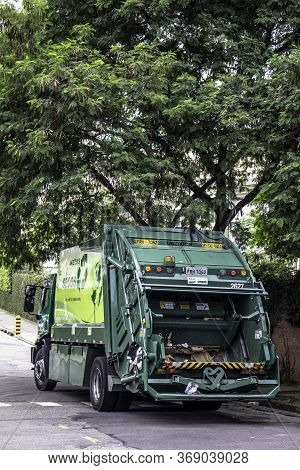 Sao Paulo, Brazil, February 27, 2015. Garbage Truck On Street Of Sao Paulo City, Brazil