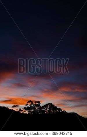 Sunset Sky With Beautiful Pink Clouds Over The Hills Of Tasmania