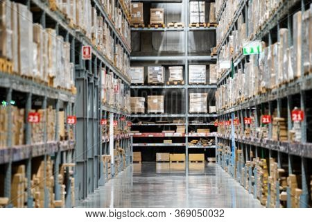 Blurred Background Of Warehouse Or Storehouse Industrial And Logistic Company.warehousing On The Flo