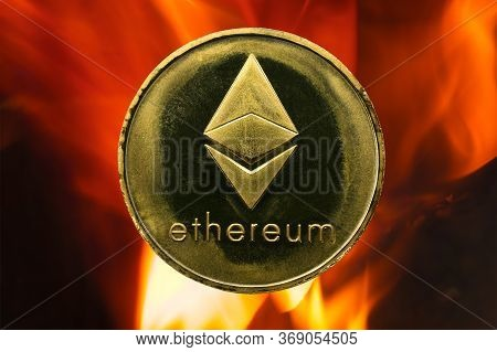 Physical Ethereum Gold Coin (eth) With Fire Or Flame Background. Cryptocurrency Bull Market Growth W