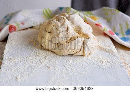 Pizza Dough Or Baking On A White Black Background Of Wood. Pastry For Bread, Dough Or Pizza/ Woman C