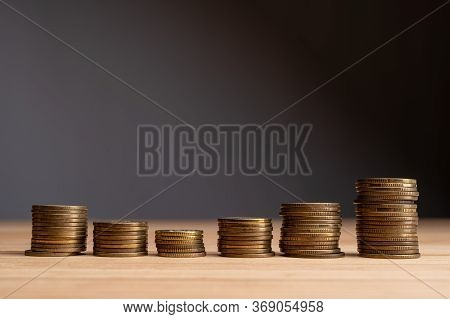 Stacks Of Coins On A Natural Wood Background. Finance Market Growth Abstract Concept. Copy Space At