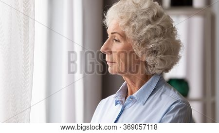 Old Woman Looking In Window Thinking Lost In Sad Thoughts