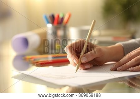 Close Up Side View Of Designer Woman Hands Sketching Drawing With Pencil On Desk At Home