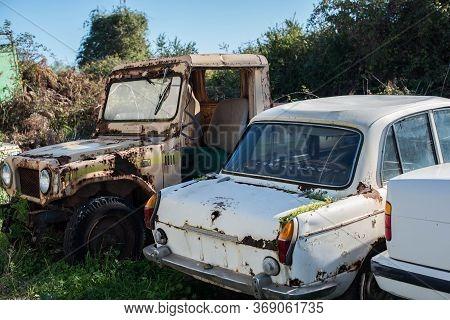 Abandoned Retro Cars In The Junkyard