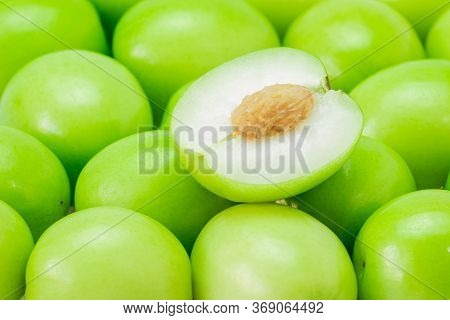 Half Of A Jujube Green Fruit, On Pile Isolated On White Background. The File Includes A Clipping Pat