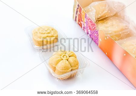 Two Piece Of Delicious Pineapple Bread Near The Colorful Box On A White Background. Copy Space, Sele