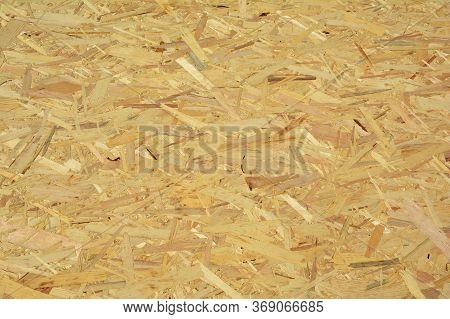 A Close-up On Oriented Strand Board, Osb Wood Panel, Flakeboard, Sterling Board, Plywood Or Sheet Ti