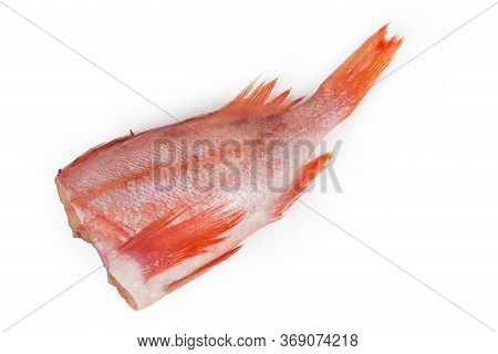 Raw Headless Gutted Carcass Of Redfish Also Known As Ocean Perch Or Norway Haddock On A White Backgr