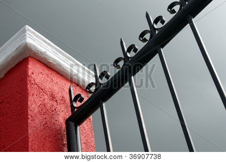 Post And Iron Fence