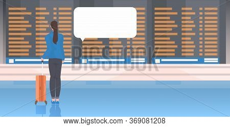 Rear View Woman With Baggage Female Traveler Standing At Airport Terminal Hall Waiting For Flight Ch