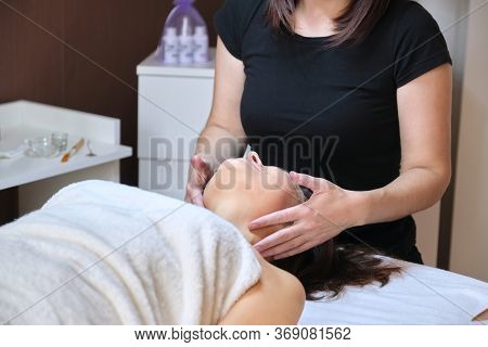 Age, Beauty, Face, Treatment Concept. Middle Aged Woman In Cosmetologist Office, Receiving Anti-agin